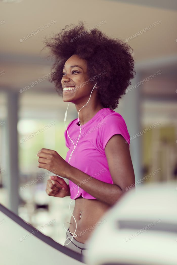 afro american woman running on a treadmill