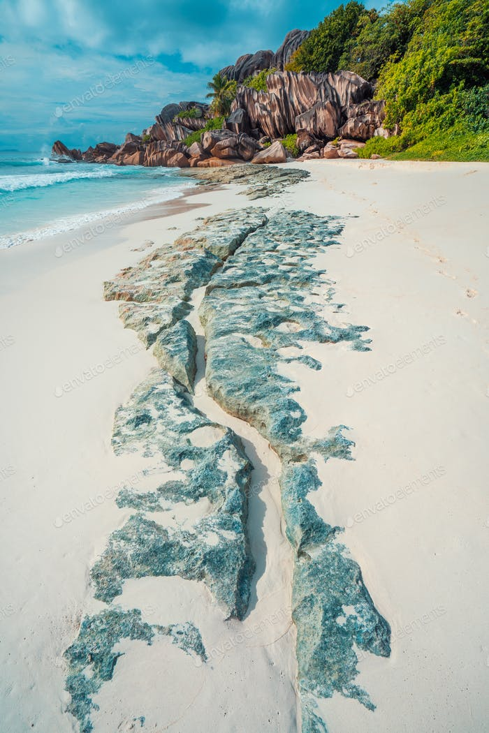 Tropical beach at Grand Anse, La Digue island, Seychelles. Beautifully shaped granite boulders