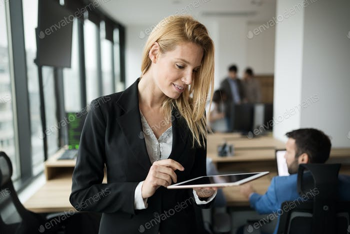 Thumbnail for Attractive businesswoman using digital tablet in office