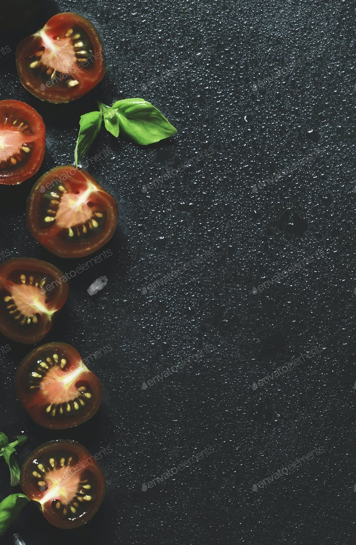 black and red cherry tomatoes and green basil
