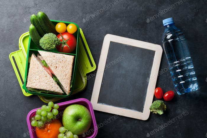 Lunch box with vegetables and sandwich