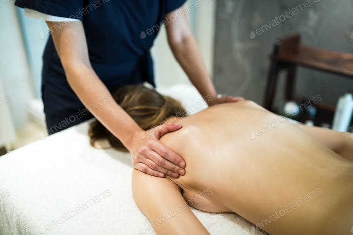 Stress relieving massage by therapist