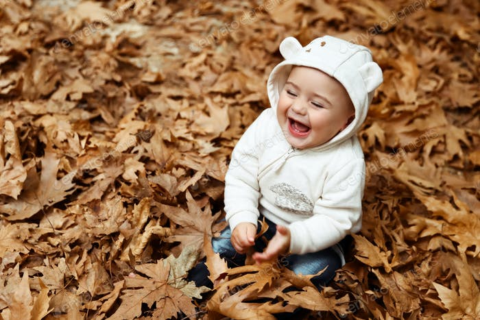 Cheerful baby enjoying autumn