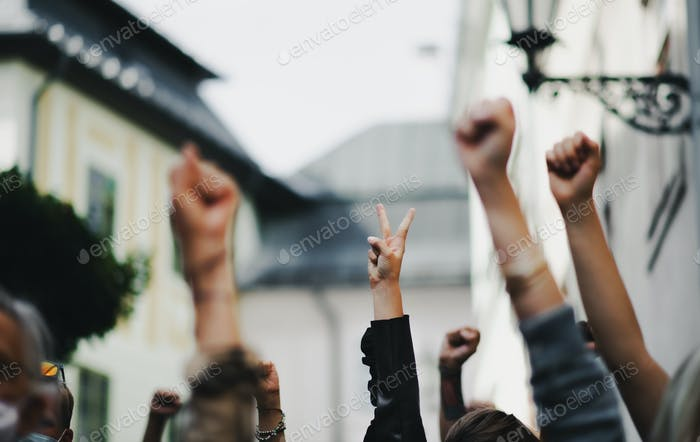Arms and fists raised in the air, protest and demonstration concept