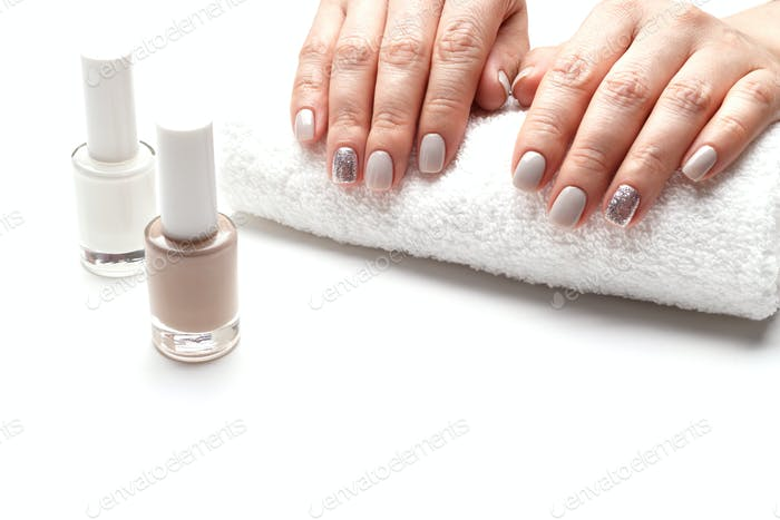 Manicured woman hands on white towel