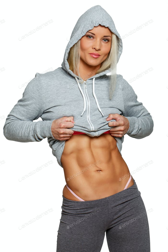 Fit woman in sportswear with barely seen panties