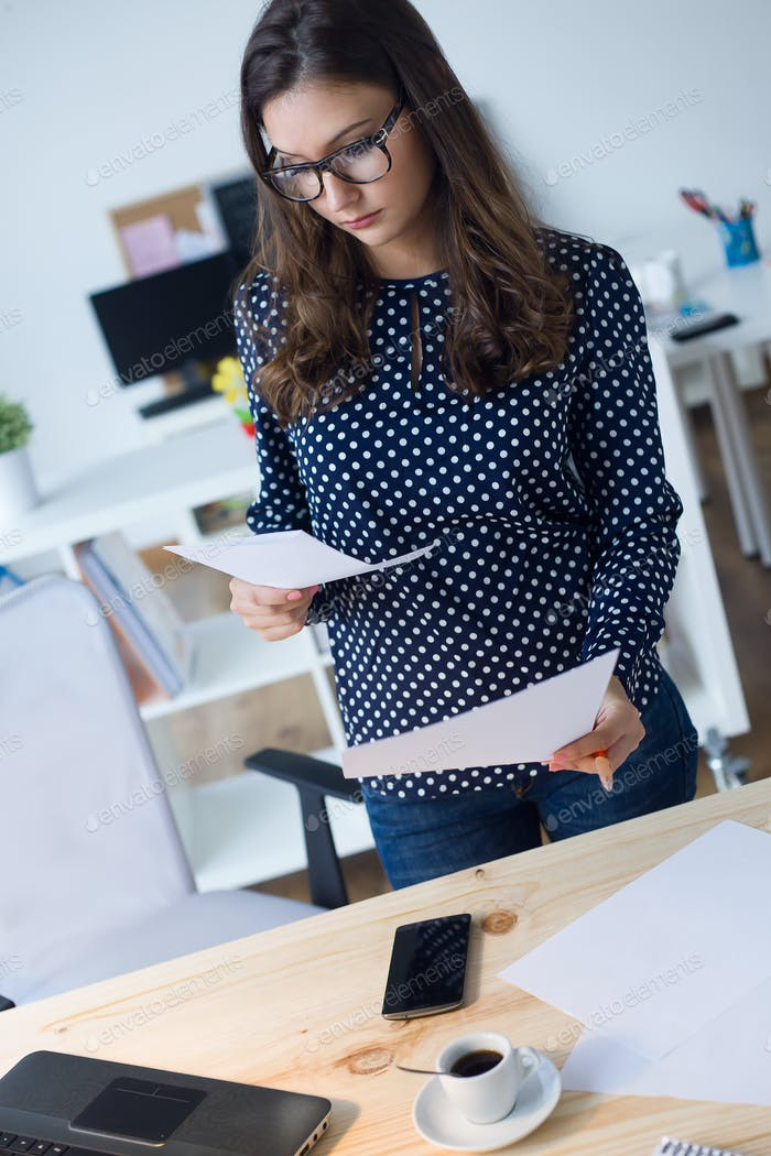 Beautiful young woman working in her office.