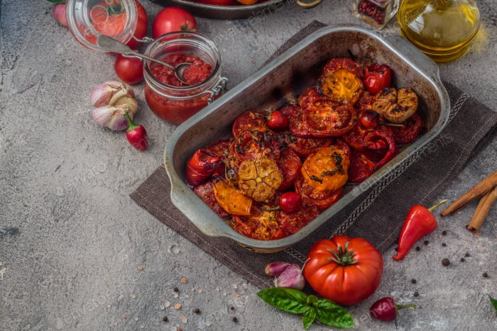 Baked tomatoes in a baking tray, copy space