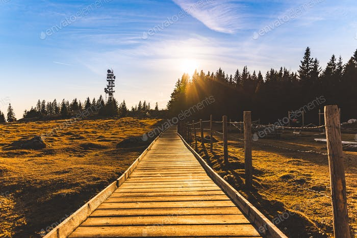 Wooden path at the top of schockl mountain in Graz Austria leading to view point