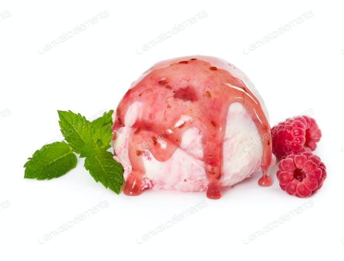 Scoop of raspberry ice cream with fresh raspberries, mint and ra