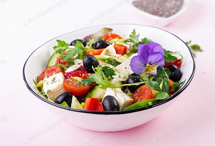 Greek salad  with cucumber, tomato, sweet pepper, lettuce, green onion, feta cheese