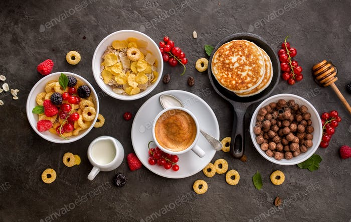 Breakfast cereals, pancakes, fresh berries and cup of coffee