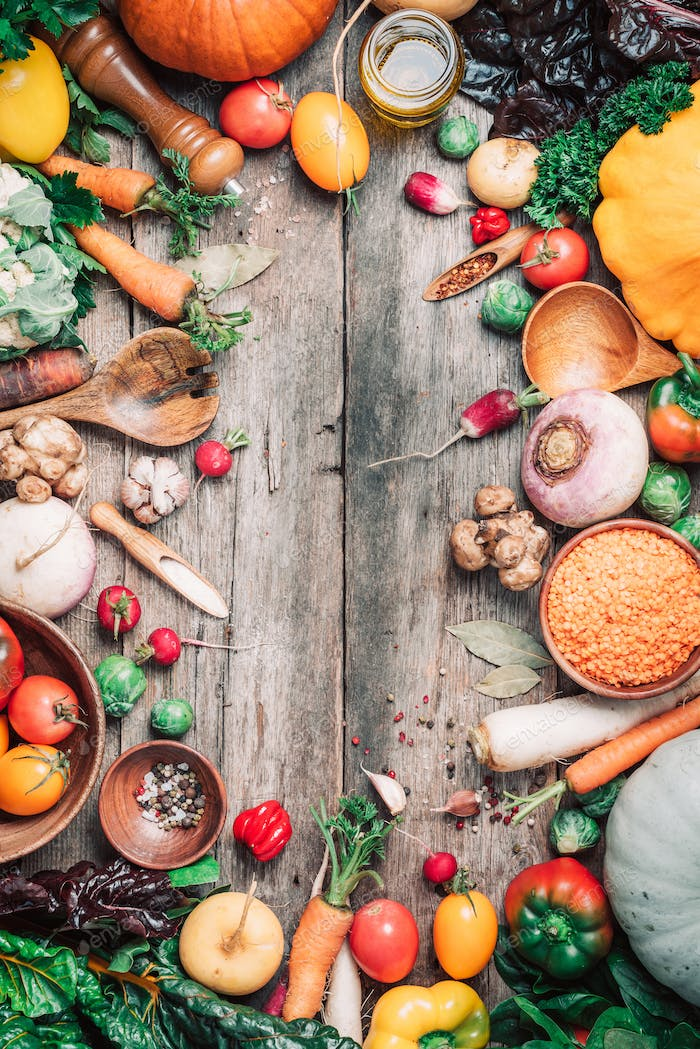 Fresh ingredients for healthy cooking or salad making on wooden background. Top view. Copy space