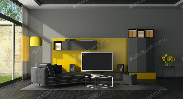 Black and yellow living room with tv set
