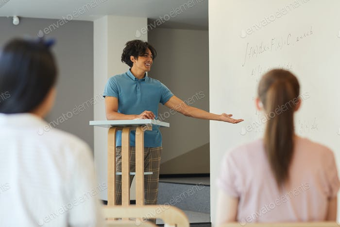 Student boy presenting his research at class