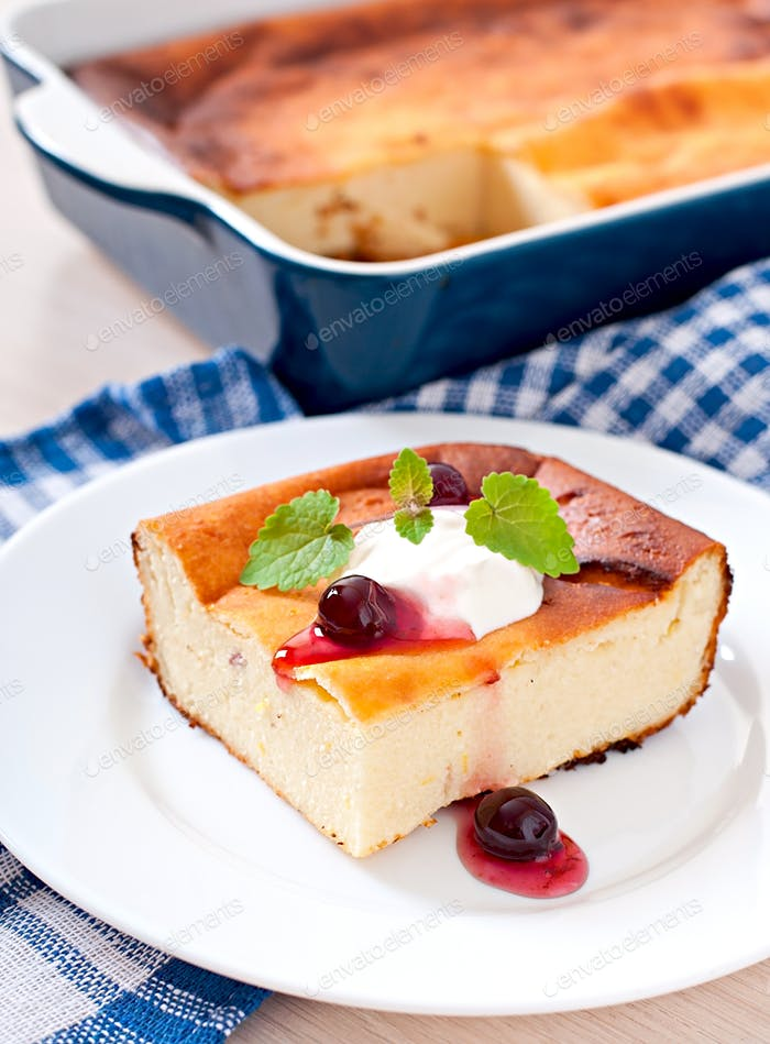 Appetizing cottage cheese casserole on white plate close up