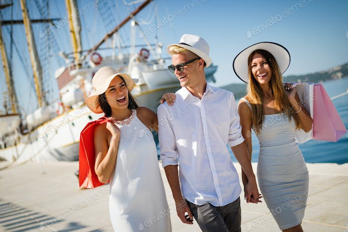 Happy people enjoying and having fun on a luxury summer vacation