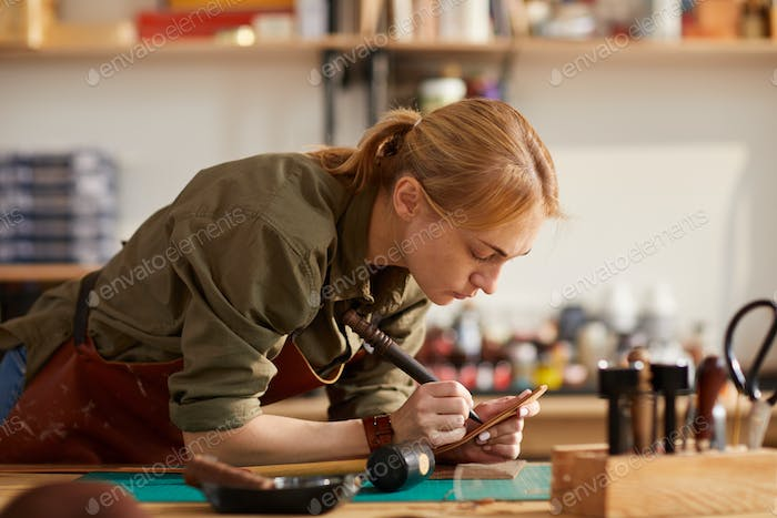 Female Craftsman in Shop