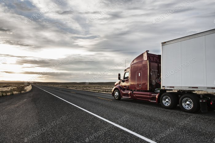 Side view of the cab of a  commercial truck on the highway in eastern Washington, USA.