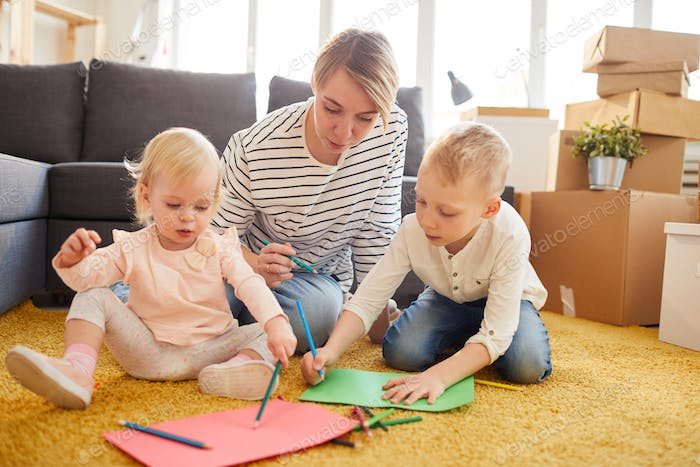 Mother teaching children to draw