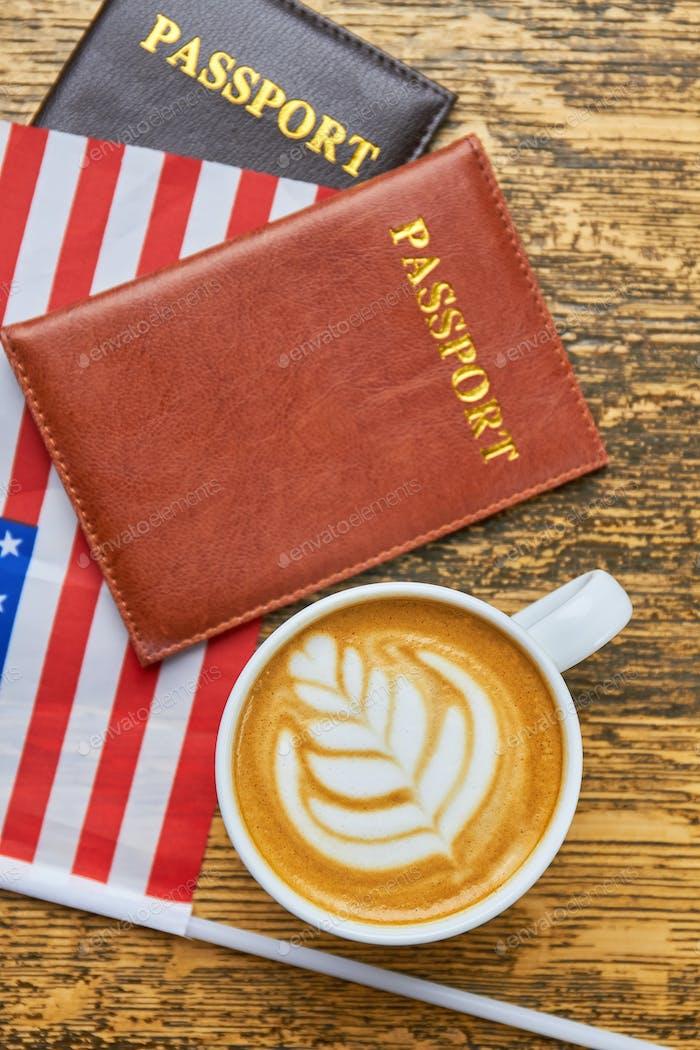 Coffee, passports and USA flag