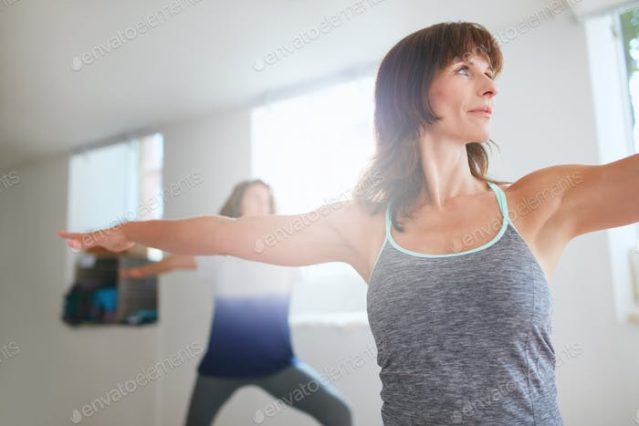 Women exercising at yoga class.