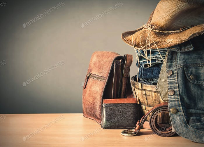 Clothing and bags on wooden