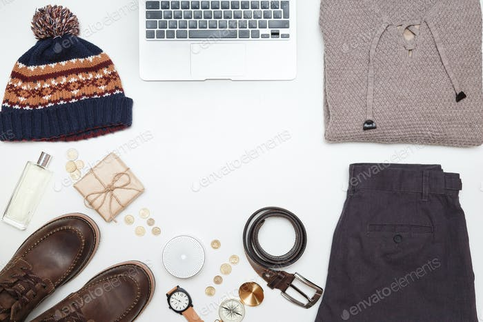 Top view of men clothes and accessories on white background