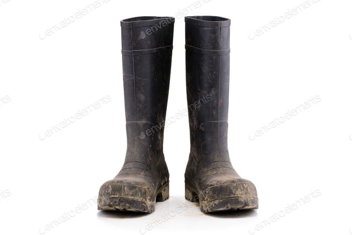 Dry dirty Mud boots isolated on white background front view