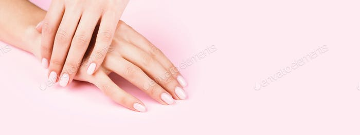 Banner with Woman's Hands with Pastel Manicure on Pink Background.