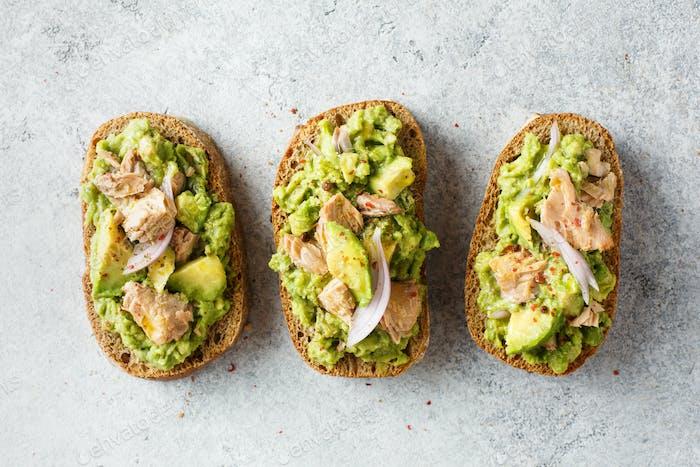 Healthy toast with avocado and tuna