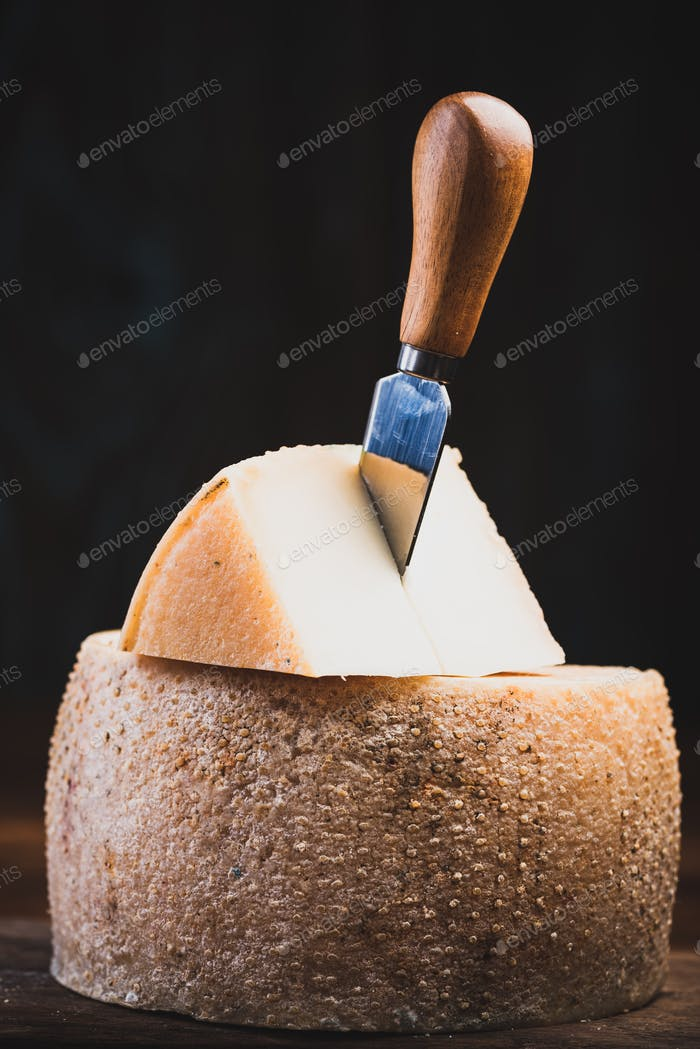 Piece Cut from Whole Matured Cheese Wheel
