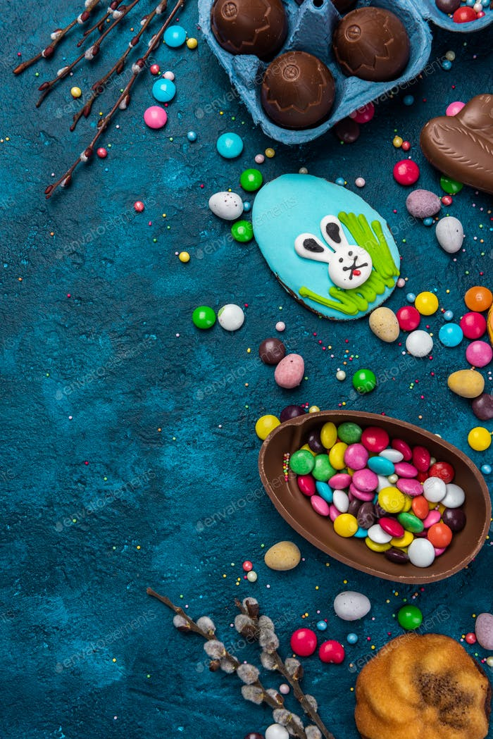 Colorful Easter Festive Background. Sweet Food Candy and Chocolate Eggs and Rabbit