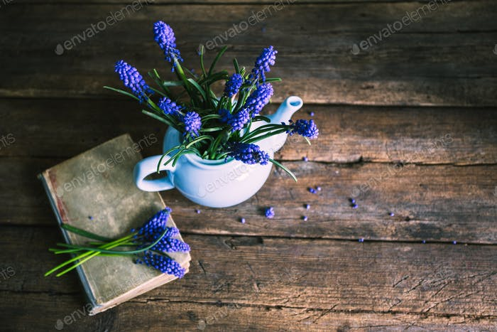 Old book with flowers in a vase. Vintage