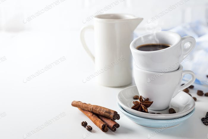 Coffee cup and beans on a white background.