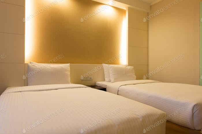Twin bed in hotel bedroom