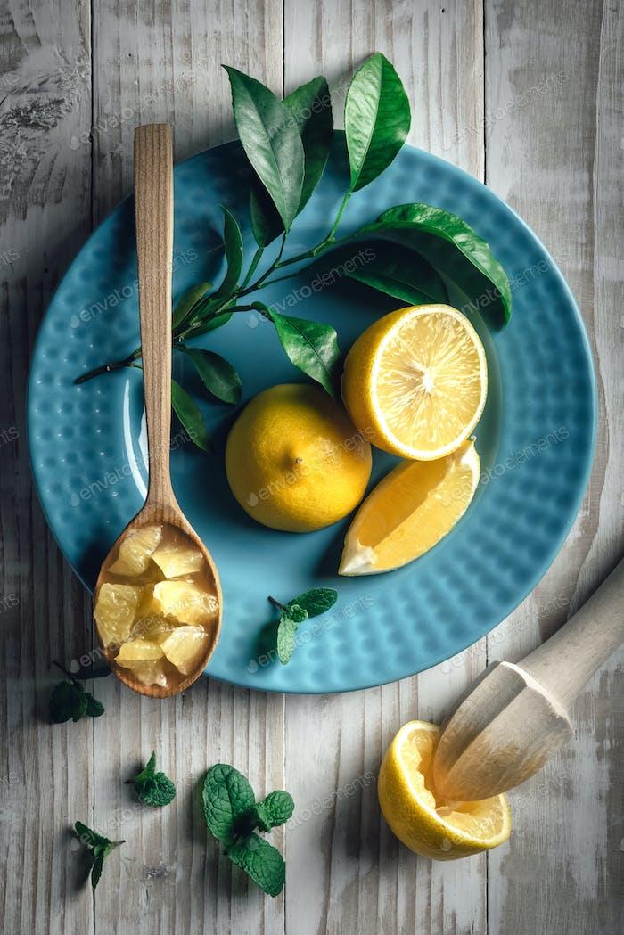 Lemon pieces on blue plate closeup