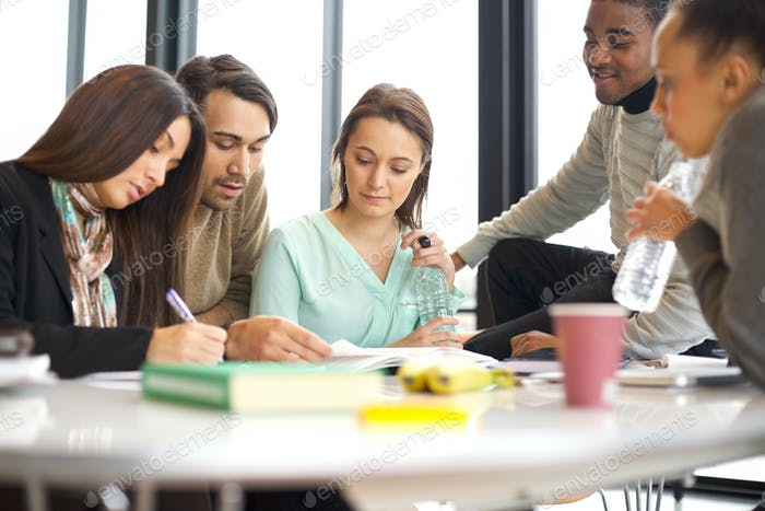 Young university students doing group study