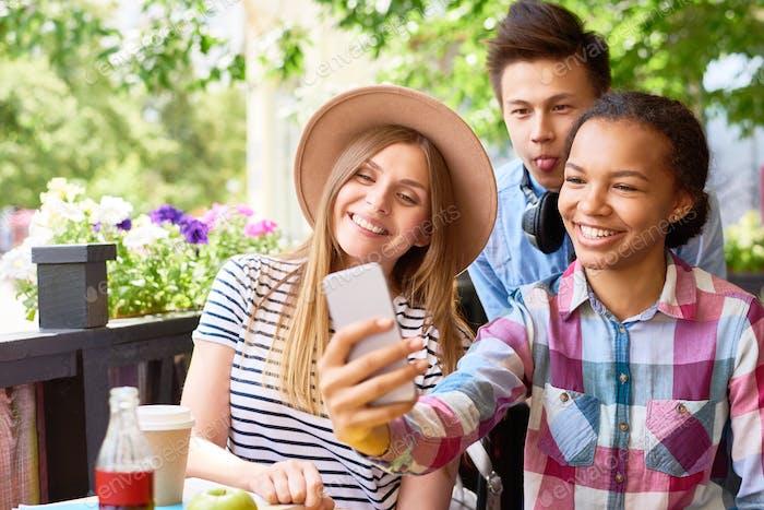 Friends Taking Selfie in Cafe