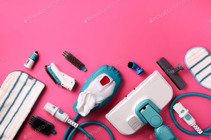 Set with modern professional steam cleaners on pink background. Top view, flat lay. Banner with copy