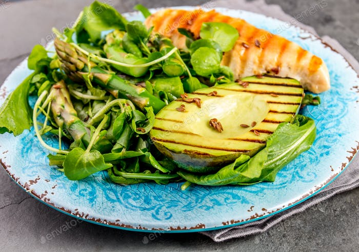 Green salad with grilled avicado and grilled chicken