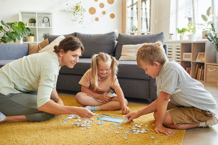 Family Playing Puzzle Game with Special Needs Girl