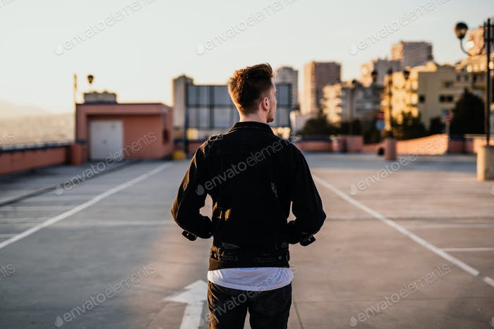 Urban young man on the roof