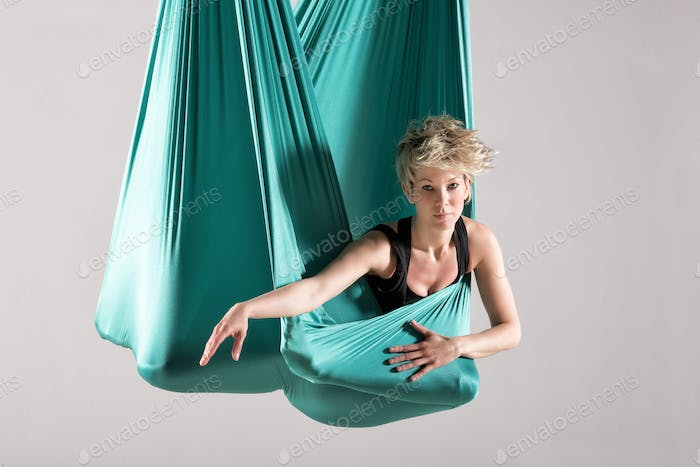 Woman wrapped in aerial yoga blanket