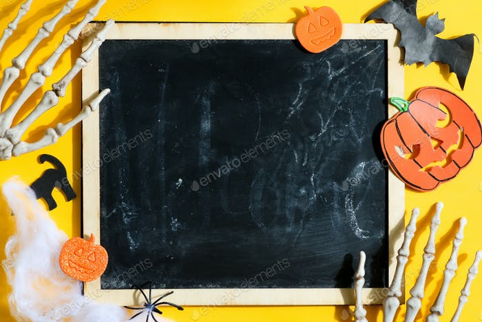 Halloween backdrop with chalkboard and skeleton hands