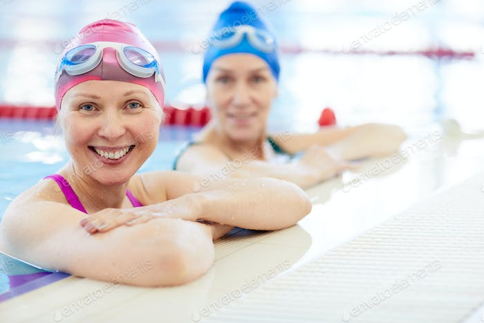 Two Adult Women in Swimming Pool