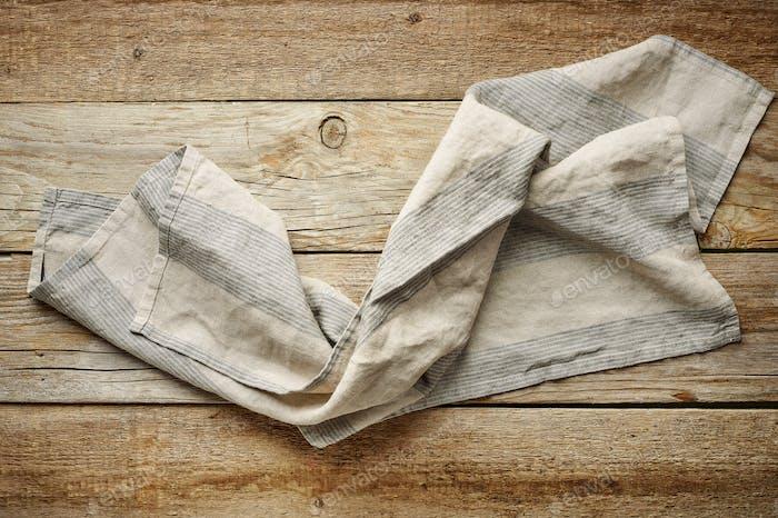 linen napkin on wooden background