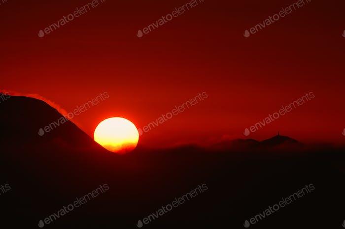 Big sun in a fiery red sunse