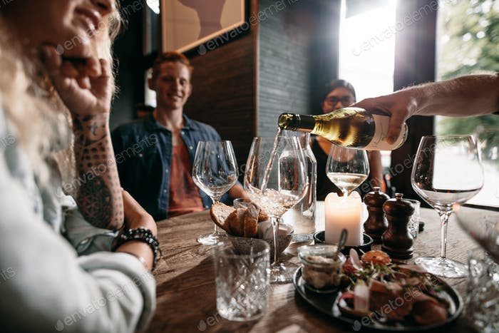 Group of young people having drinks at restaurant