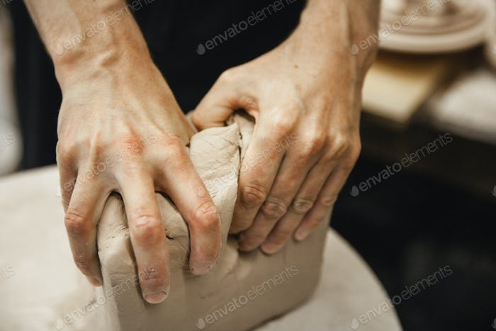 unrecognizable potter master preparing the clay